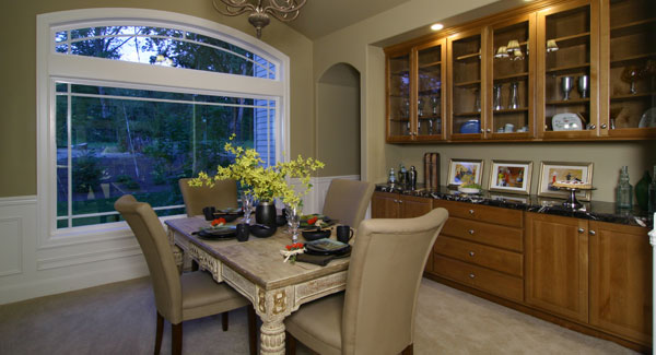 A large wooden display cabinet with a black marble countertop completes the dining area.