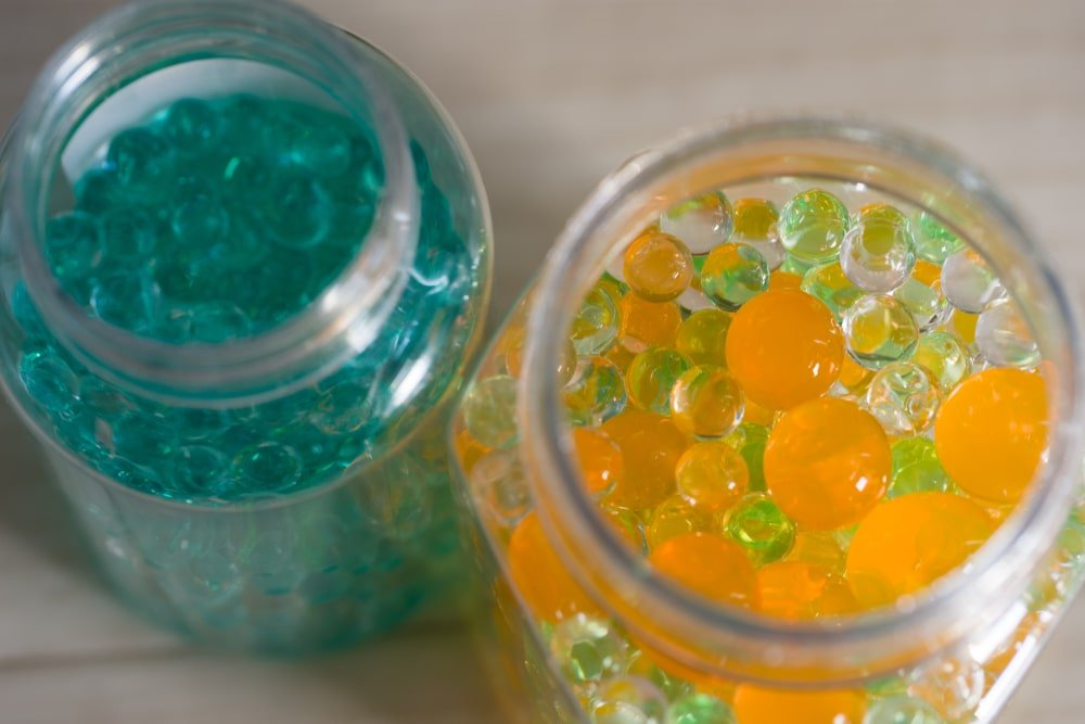 A couple of jars filled with colorful aroma beads.