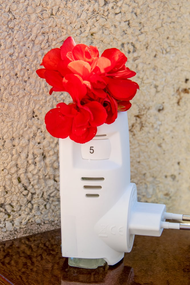 A close look at a domestic air freshener that can be plugged into an electrical socket.