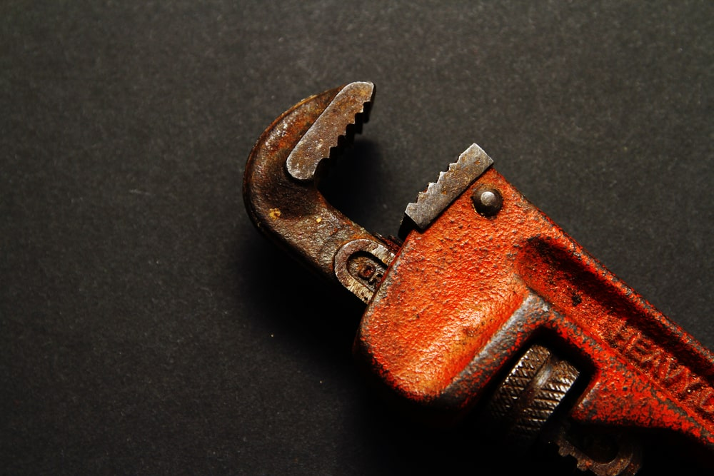 A close look at a rusty heavy-duty clamp.