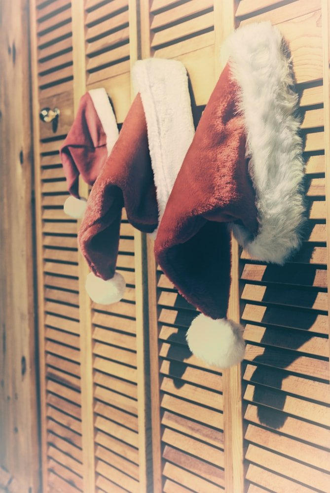 This is a close look at bifold doors adorned with Santa hats.
