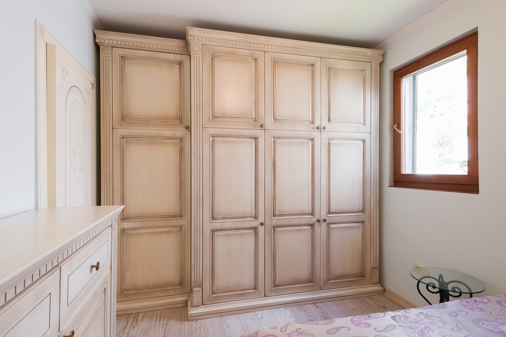A look at a set of Pocket doors on the wooden closet.