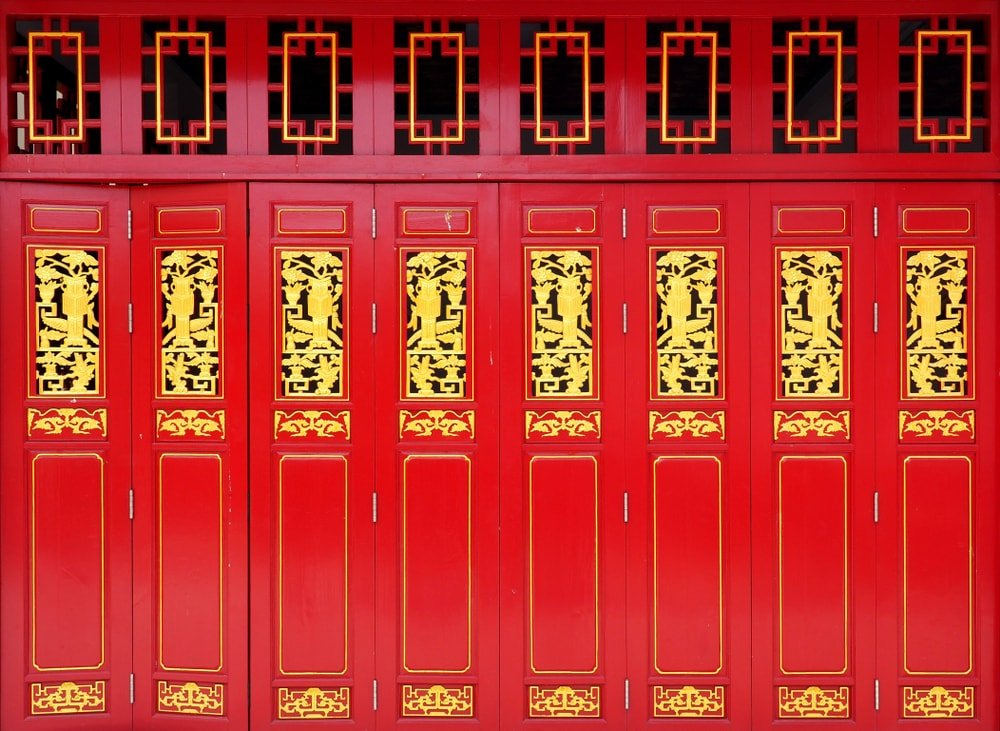 This is a set of vibrant red and gold accordion doors.