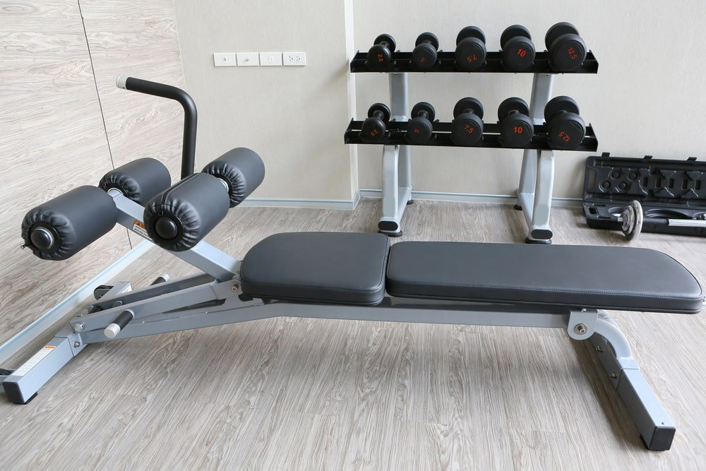 This is a cushioned weight bench with a leg rests.