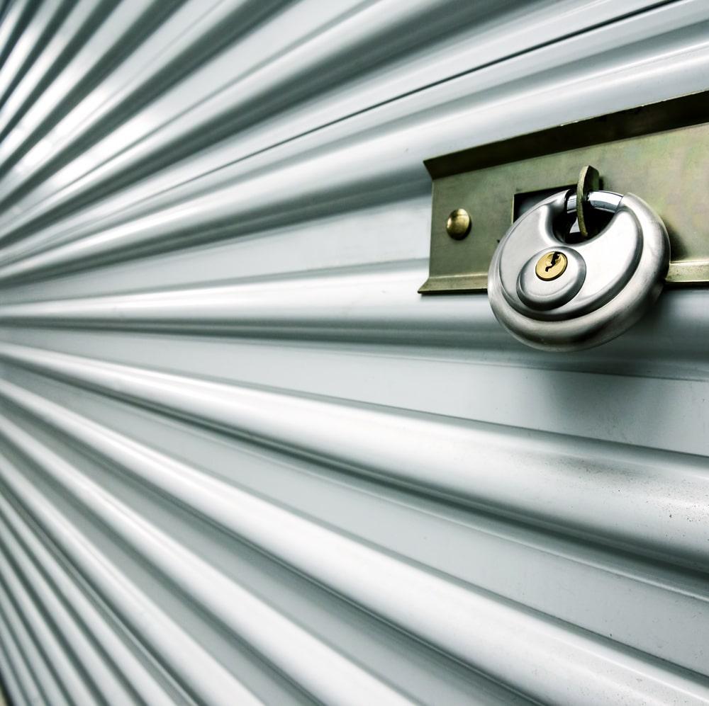 A close look at a lock of a storage unit.