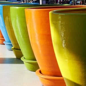 A row of large colorful pots.