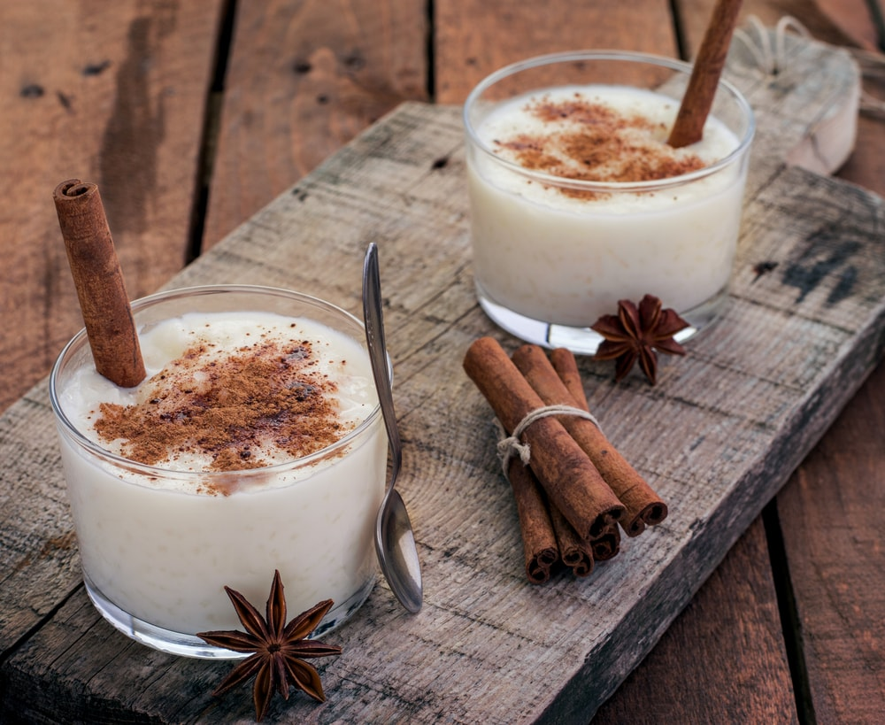 A couple of glasses of rice pudding with spices.