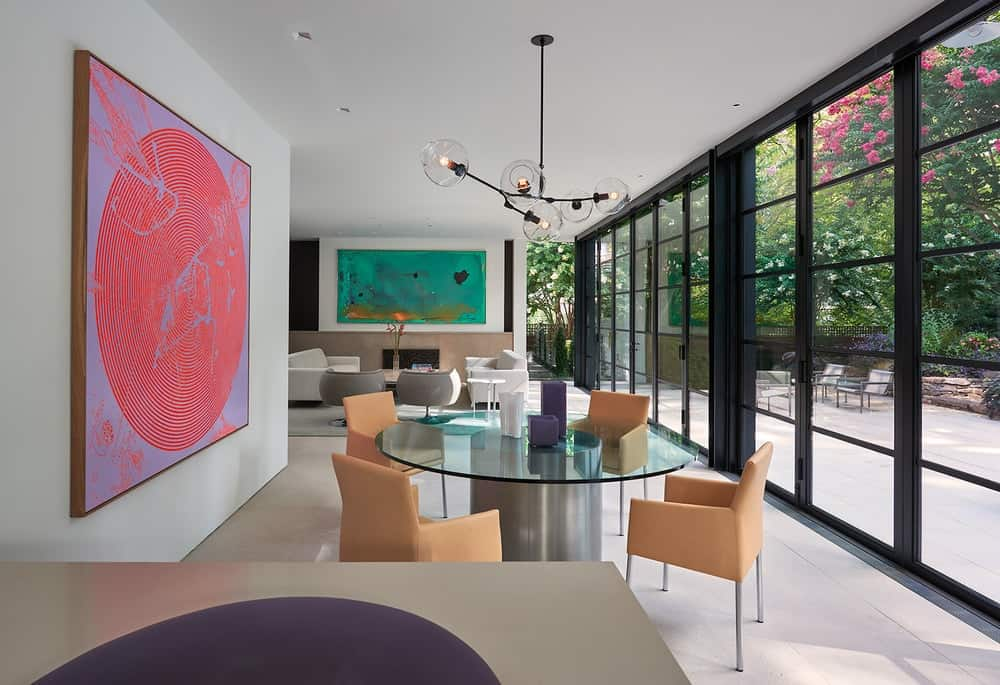 A few steps from the living room is the dining area with a large glass-top dining table.