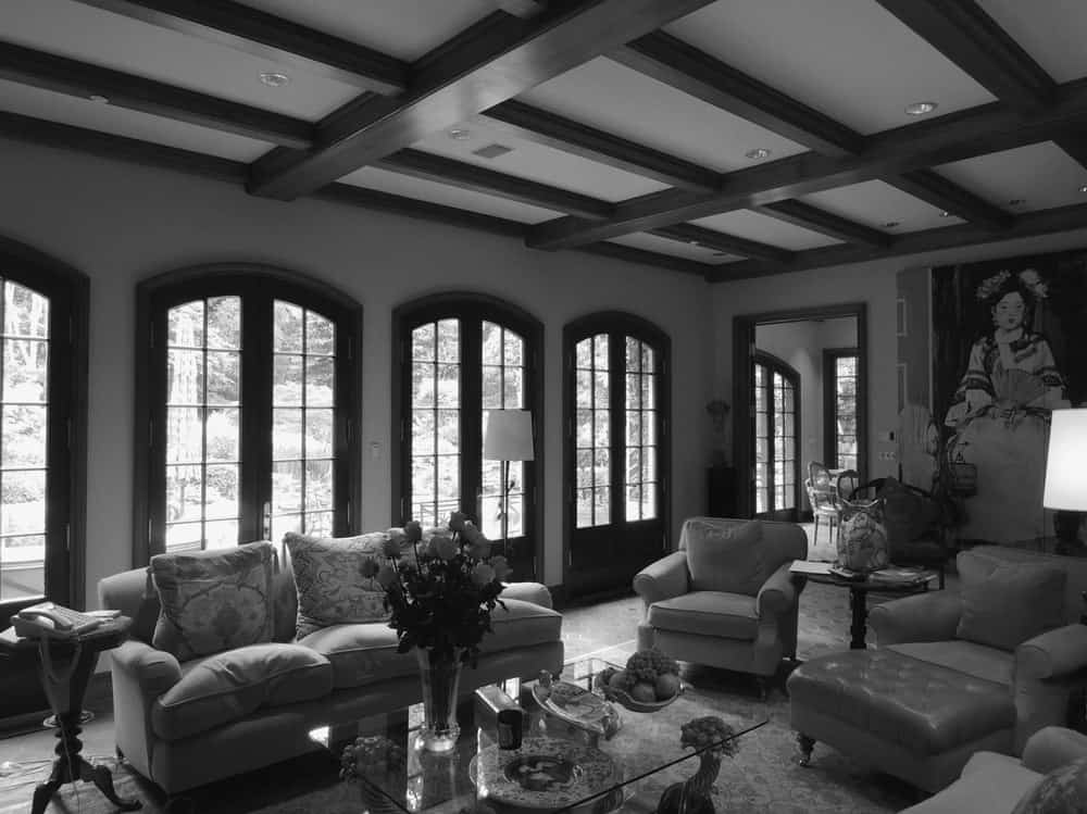 This is another angle of the old living room with a row of arched glass doors on one side leading to the back.