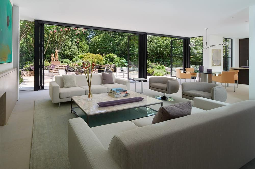 One side of the living room opens up with retractable glass doors that lead to the backyard.