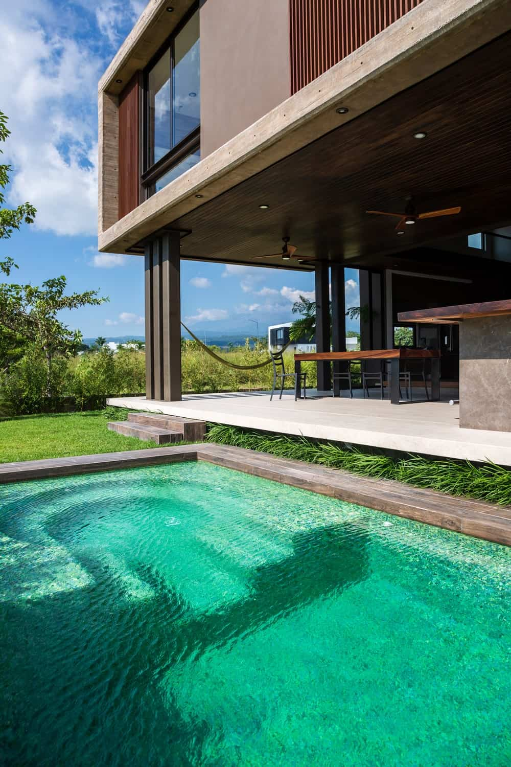 This view of the pool shows the proximity of the pool to the covered patio.