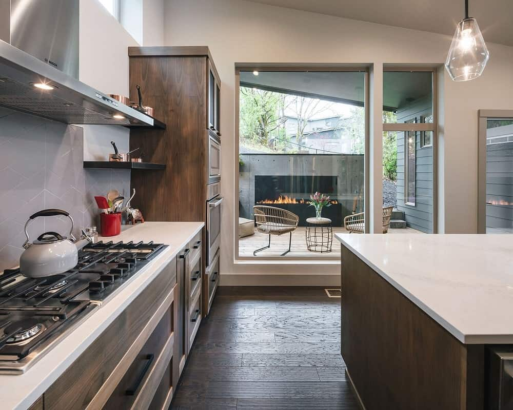 At the far end of this kitchen is a set of glass doors that lead to the patio.