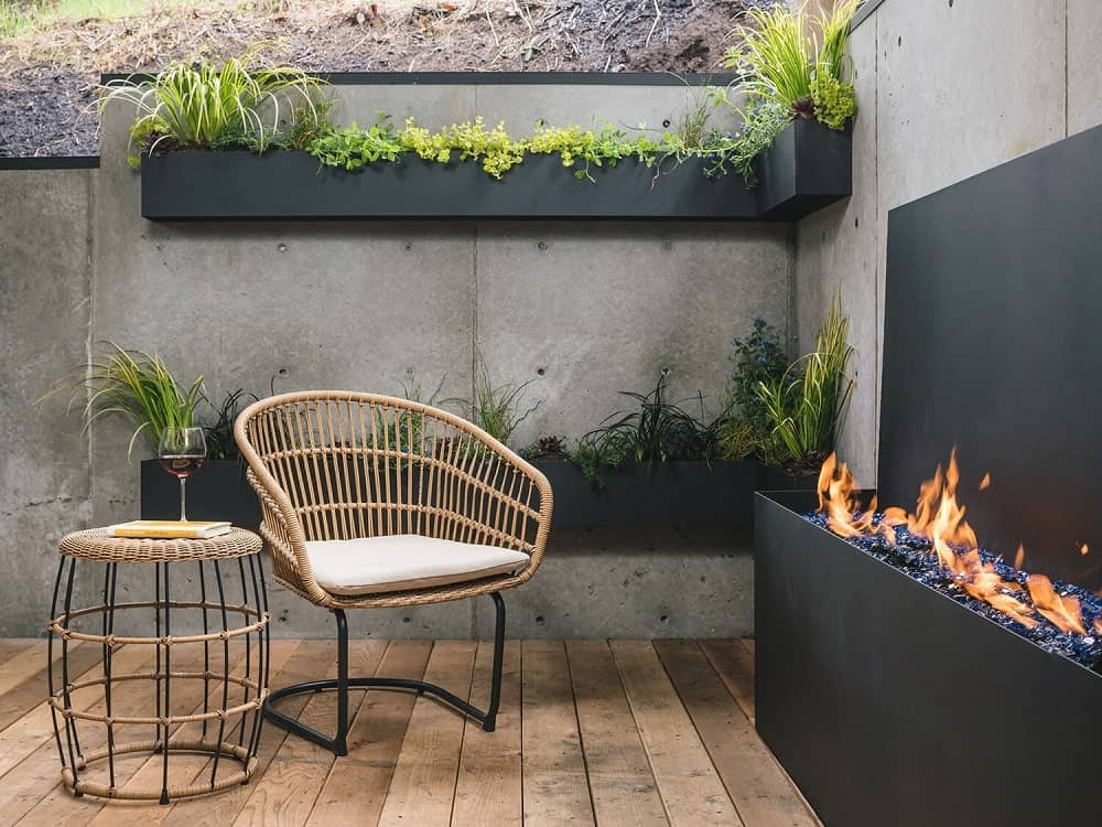 This view showcases the concrete wall at the background with floating planters on two levels.