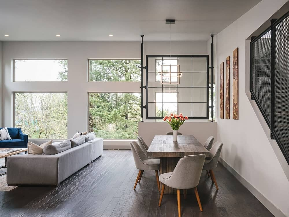 A few steps from the living room's sofa is a dining area that is complemented by the dark hardwood flooring.