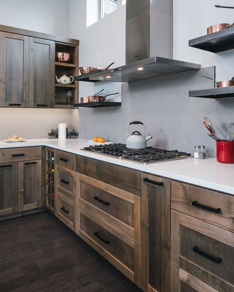 This close look at the cabinetry of the kitchen showcases its wooden structures that match the tone of the hardwood flooring.