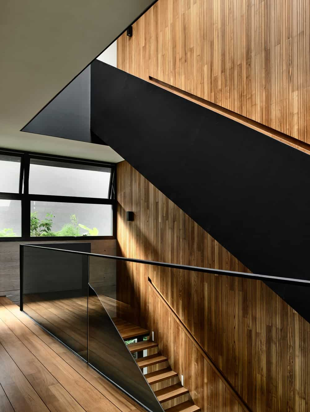 The other side of the staircase also hase large window to bring in natural lighting for the stairs.