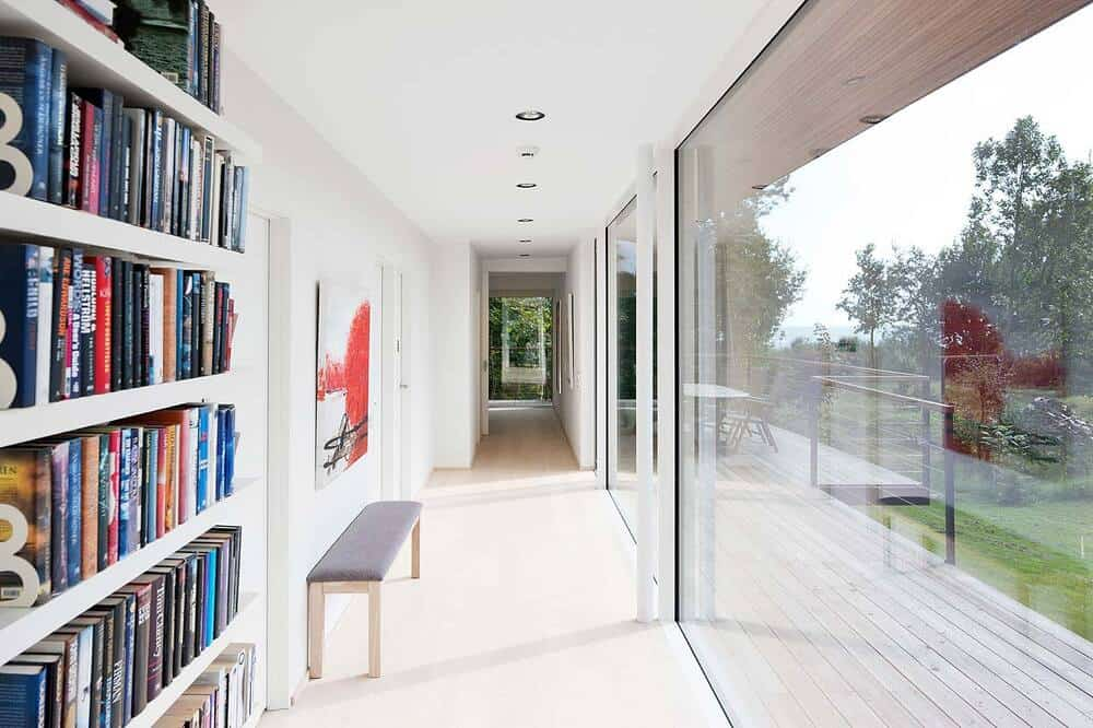 This is an interior view of the bright and white walls and ceiling of the house illuminated by the natural lighting.