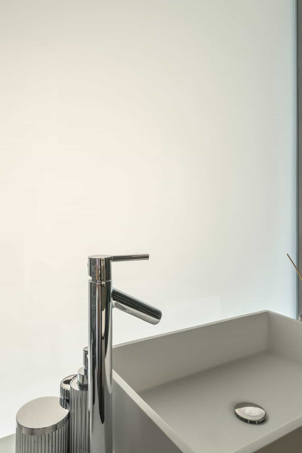 This glass panel can be made opaque to provide privacy for the bathroom.