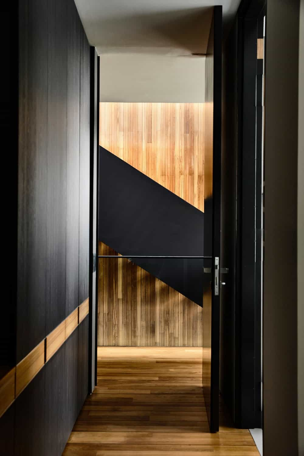 This is a look at the hallway and stairs from the vantage of inside one of the bedrooms.