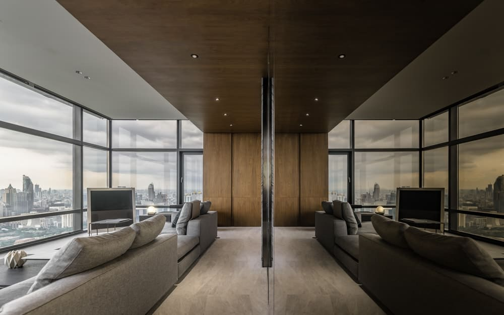 This view shows the reflection of the whole living room on the mirrored panel.