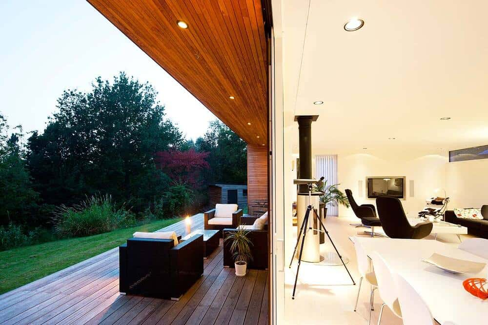 This is a view that showcases the differences between the interior living room and exterior patio of the house.