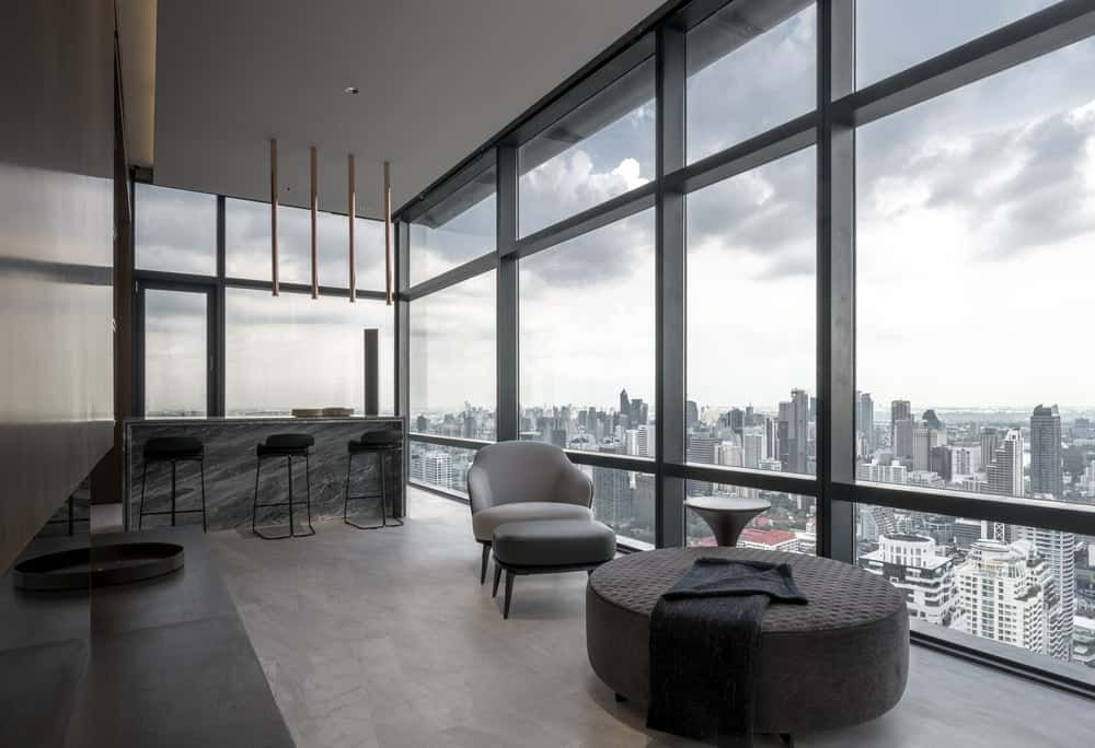 A few steps from the living room is this sitting area and reading nook by the glass wall.
