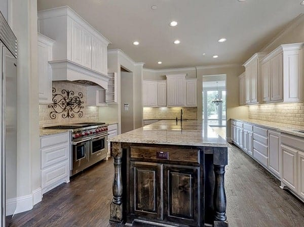 Recessed lights fitted on the regular ceiling illuminate the kitchen.