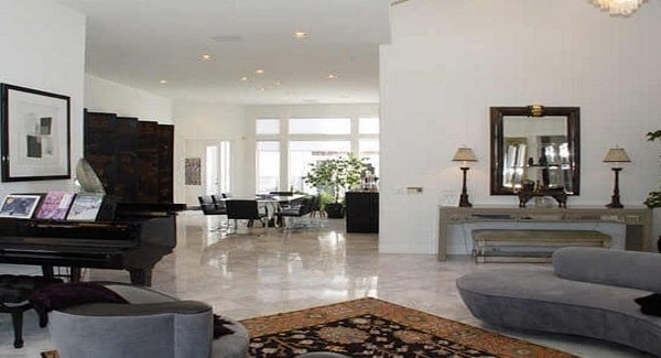 The open layout view shows the foyer, living area, and formal dining room flooded with natural light.