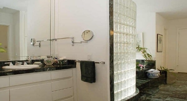 The primary bathroom is equipped with white vanity, a contrasting bathtub, and a walk-in shower.