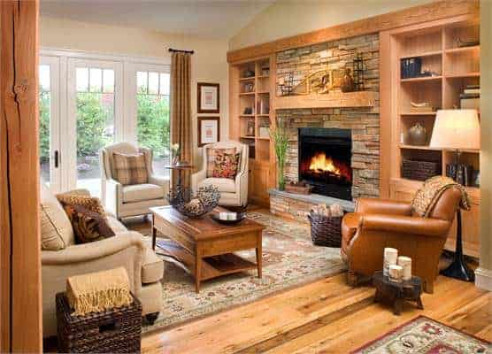 The living room has leather and beige fabric seats, a wooden coffee table, a stone fireplace, and wooden built-ins.