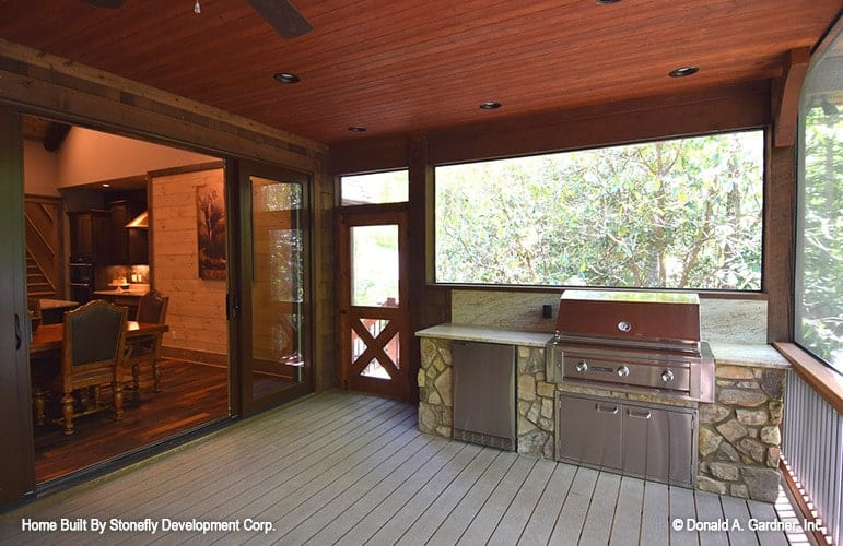 A summer kitchen with a stone counter completes the screened porch.
