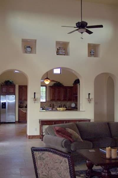 Open arches separate the kitchen from the living room.