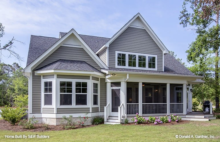 Rear exterior view showing the bay window, huge dormer, and a screened porch.