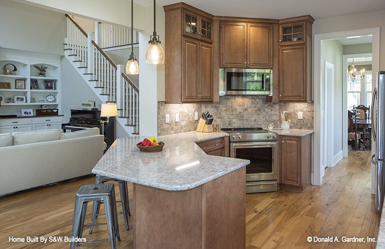 A curved peninsula separates the kitchen from the living room.