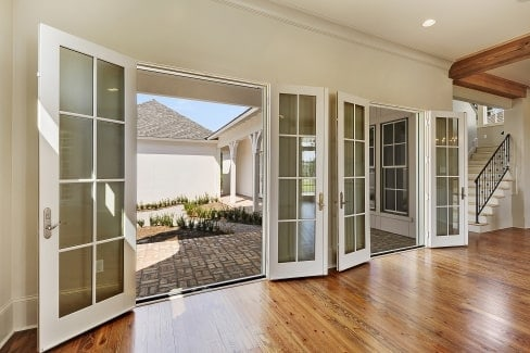 Two sets of french doors in the living room open to the back porch.