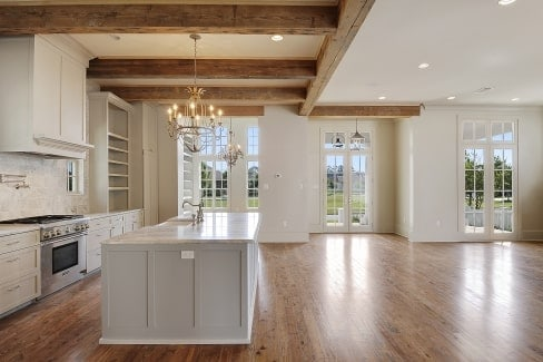 An open layout view showing the kitchen, dining area, living space, and foyer.