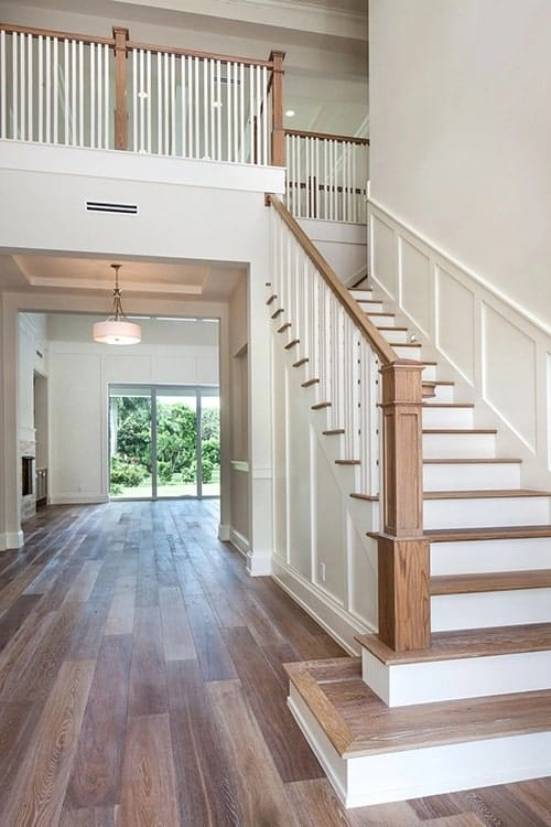 Foyer with a wooden staircase and a great view of the living room.