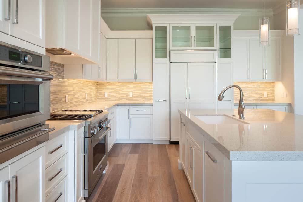 A closer look shows the stainless steel appliances and an undermount sink fitted on the breakfast island.