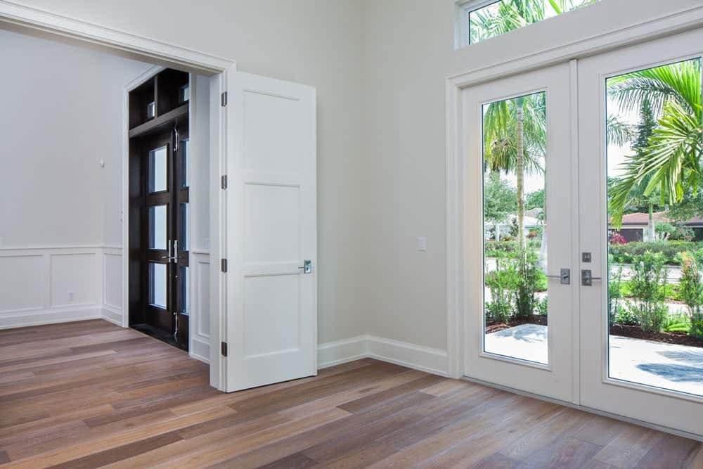 Main entrance with a french door and a white double door on the side that leads to the study.