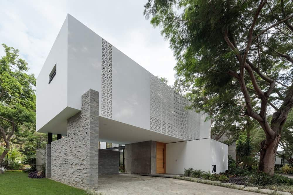 This side of the car port showcases the large gray stone wall that supports the second level structure of the house. This also matches the wall on the main entrance of the house.