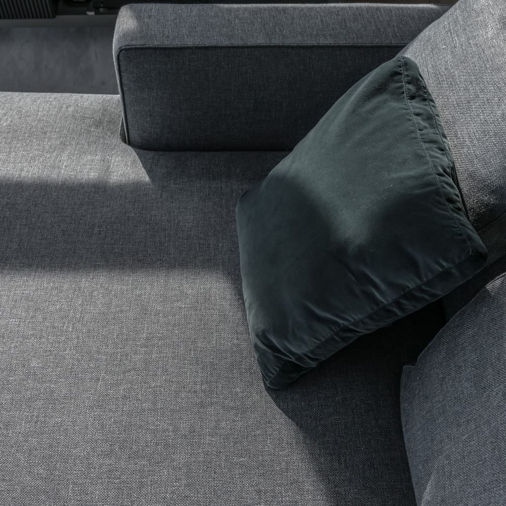 The gray sectional sofa is complemented by the charcoal gray throw pillows.