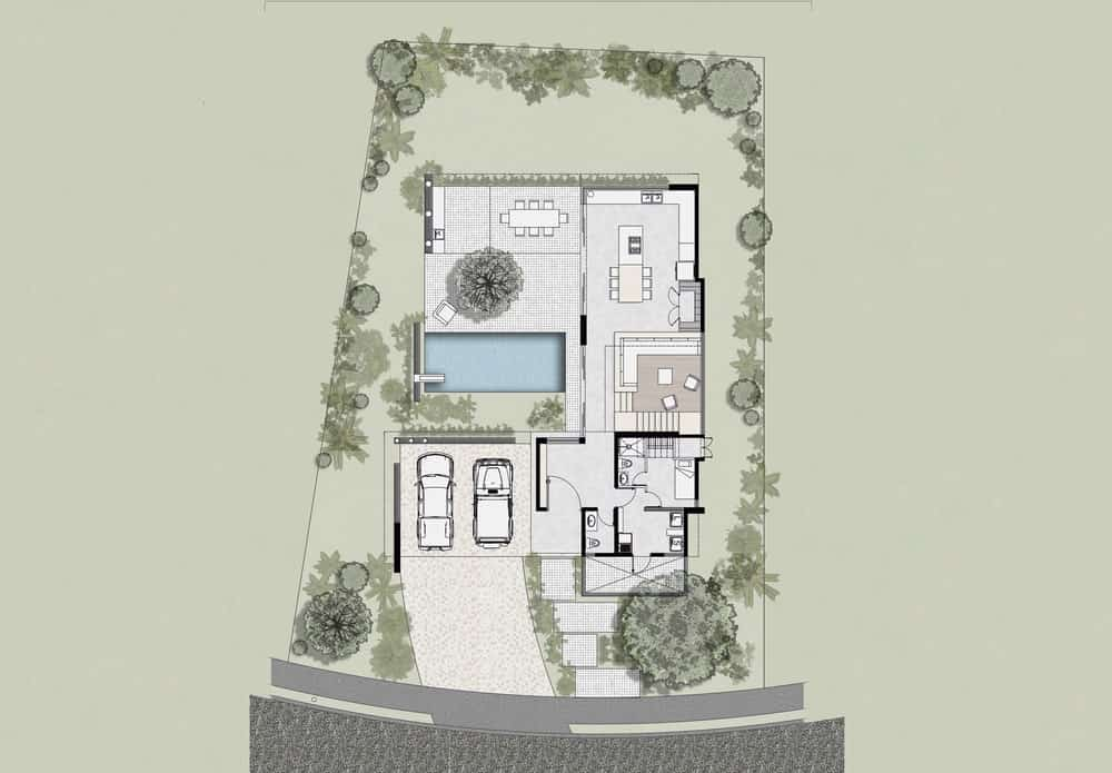 This is the first level floor plan for the whole property that showcases the sections of the house as well as the outdoor areas and landscaping.