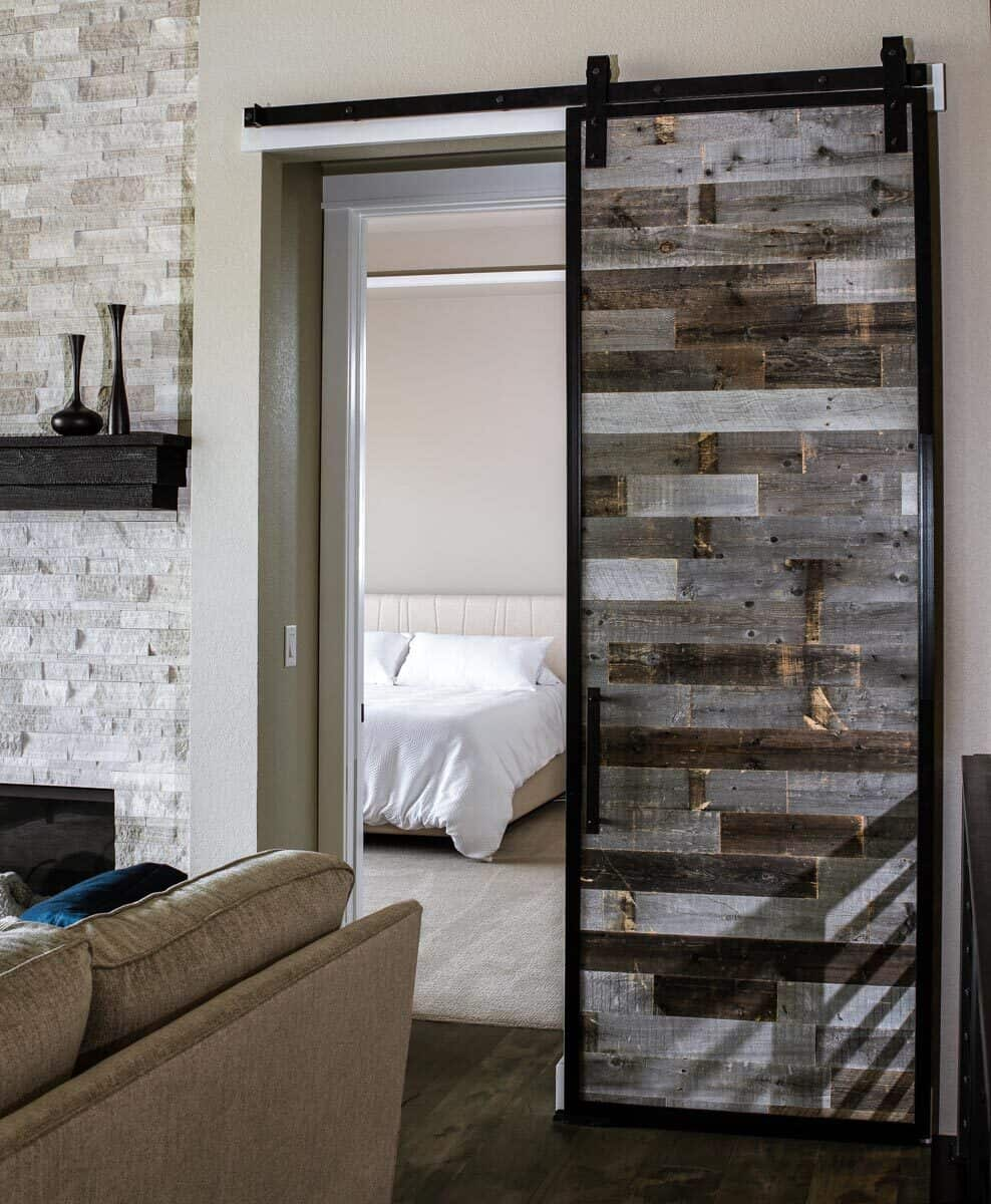 A sliding barn door opens to the primary suite.