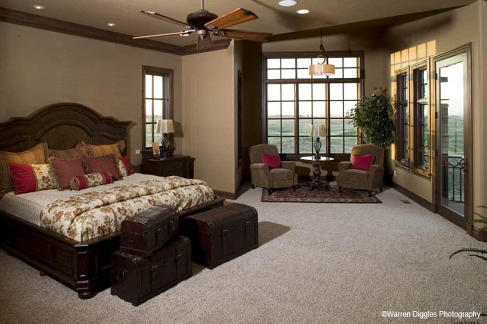 The primary bedroom has carpet flooring, a sitting area, and private access to the rear deck.