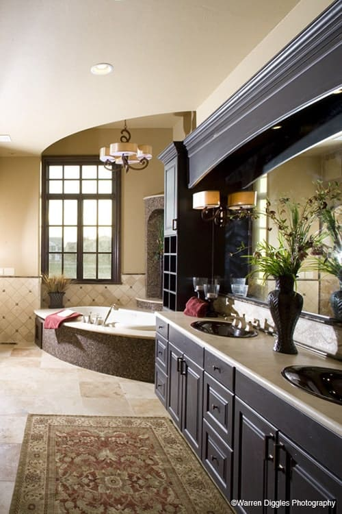 Primary bathroom with a large vanity and a corner tub fixed against the alcove.