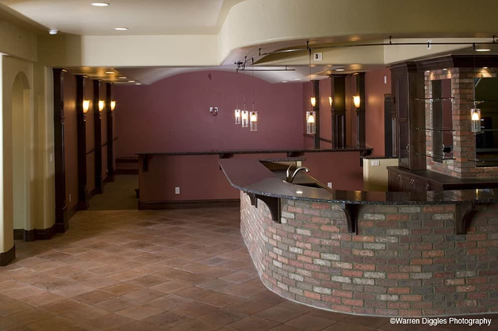 Recreation room with a large wet bar. A peninsula across defines the home theater.
