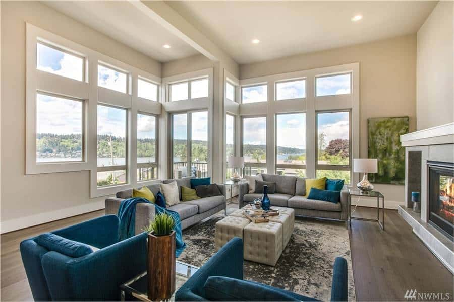 Glass windows and doors surrounding the living area bring in an abundant amount of natural light.