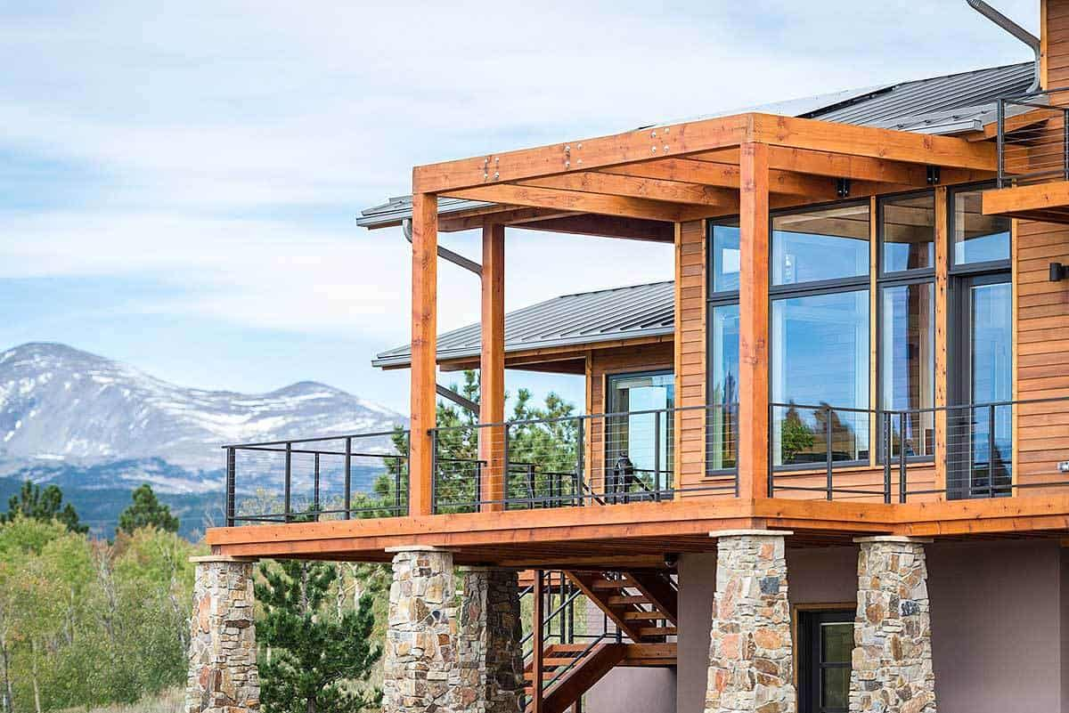 Rustic wood beams and wrought iron railings frame the side deck.