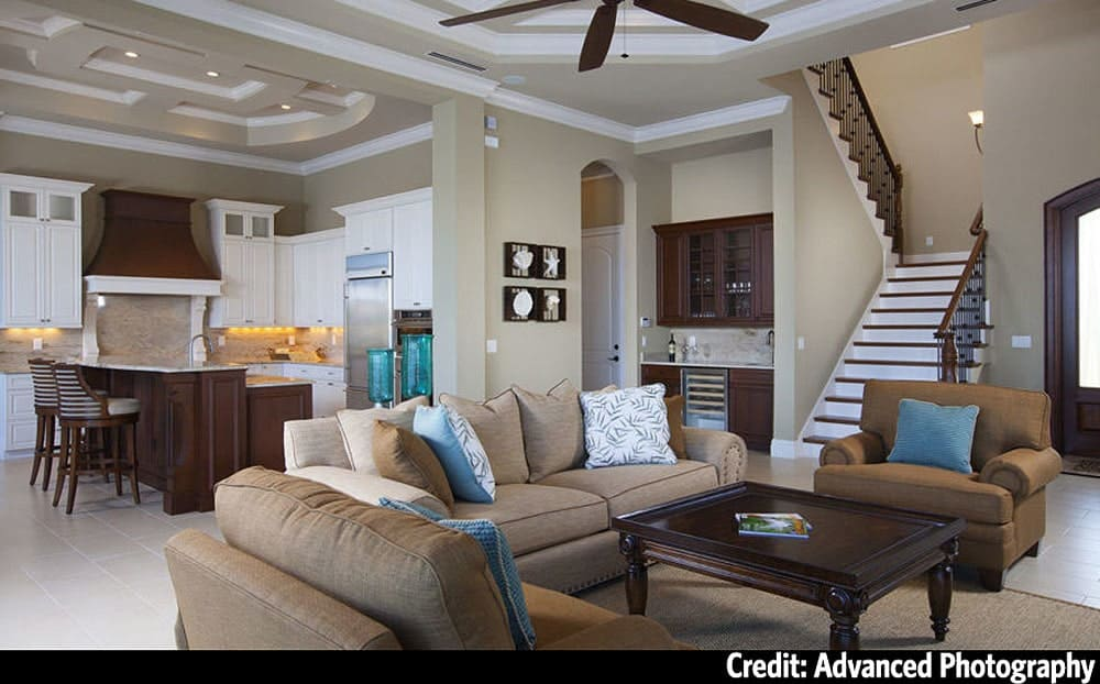 An open layout view showing the foyer, living area, wet bar, and kitchen.