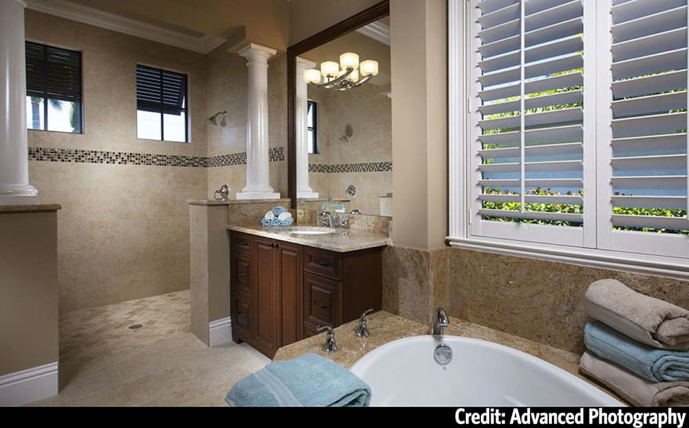 The primary bathroom is equipped with a deep soaking tub, wooden vanity, and a spacious shower area.